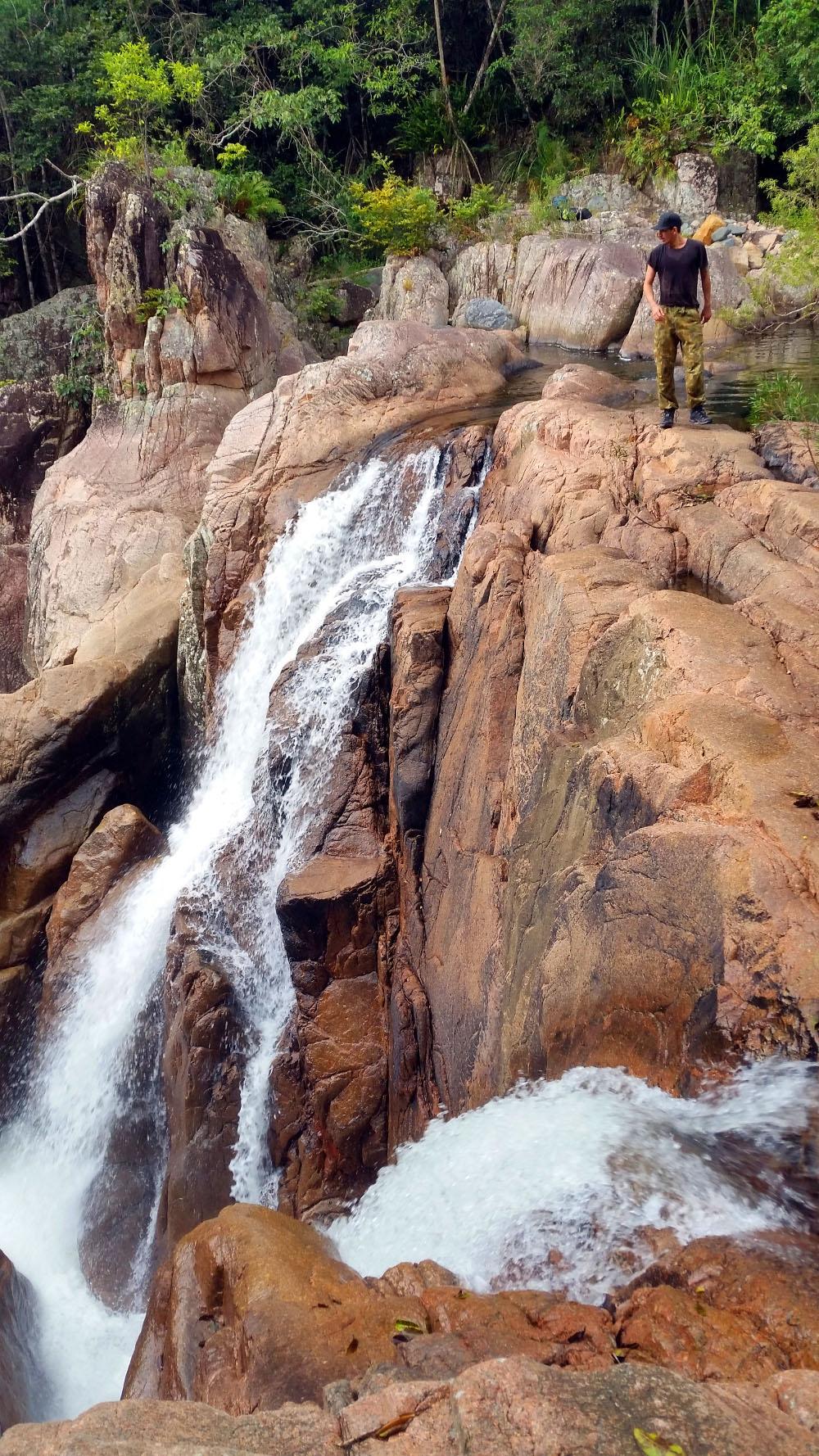 Matthew Robinson walking on top of a waterfall