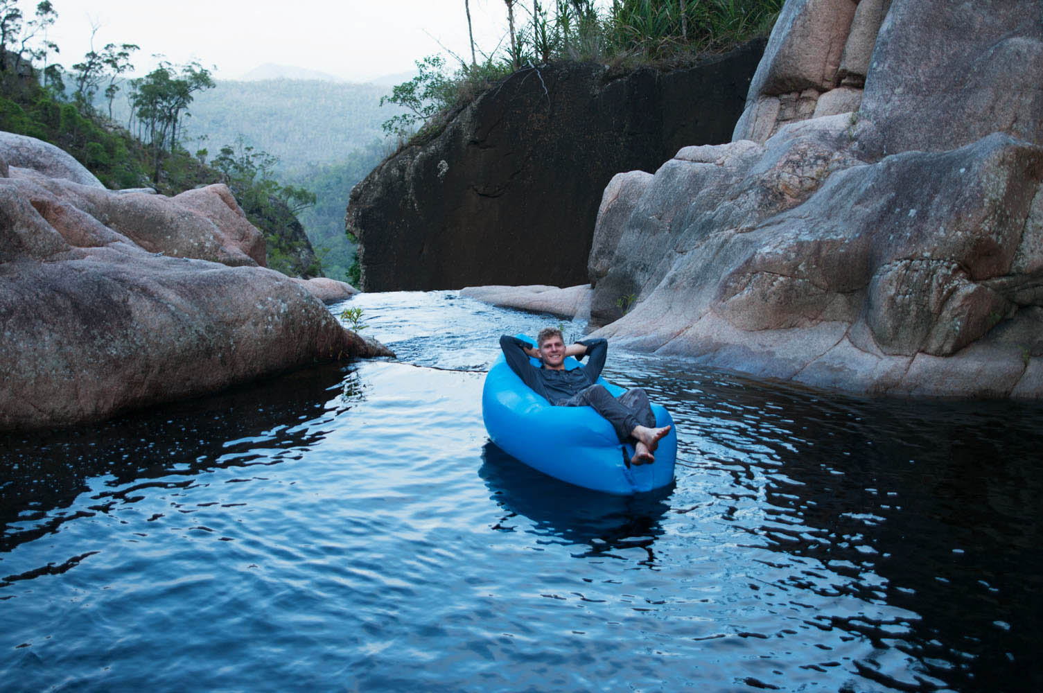 floating on water at the top of Jourama Falls
