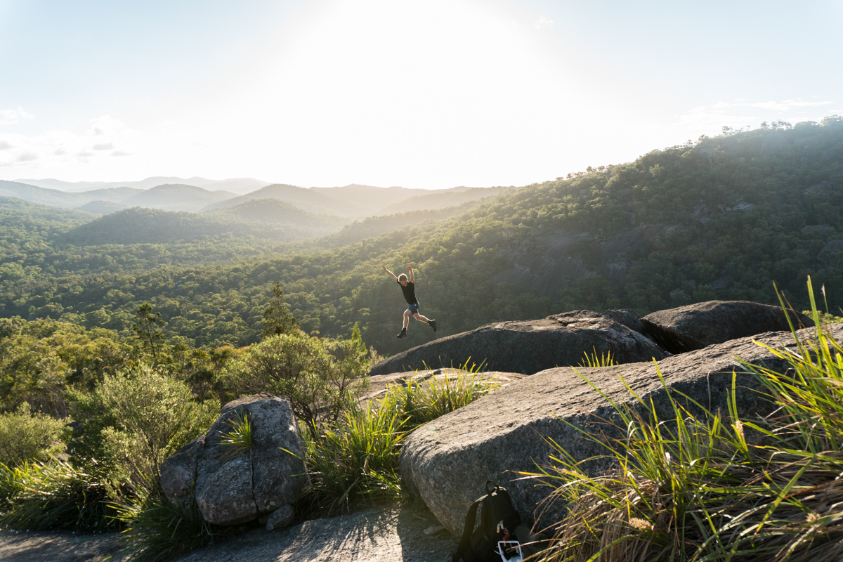 Jumping rock to rock at the Pyramid, Girraween NP
