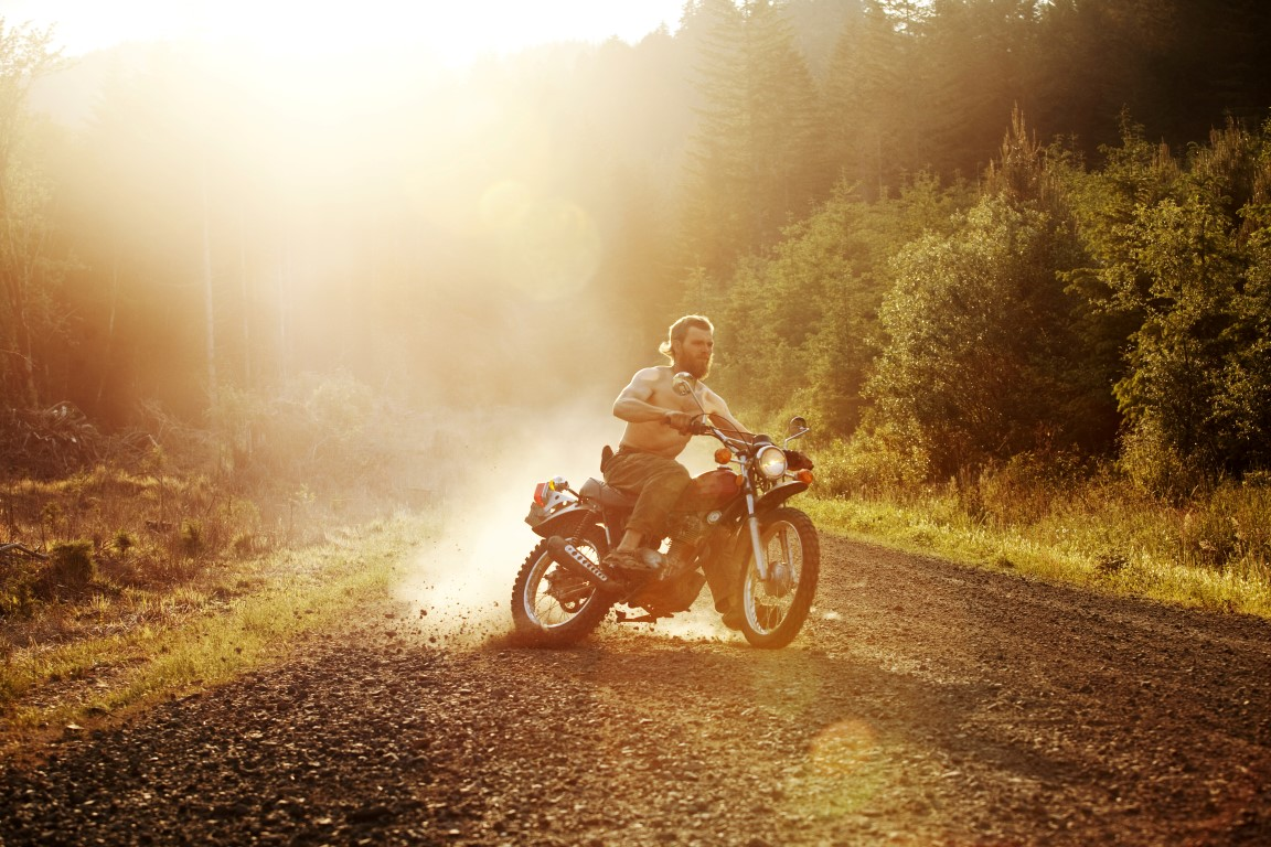 Riding a motorcycle on a dirt road