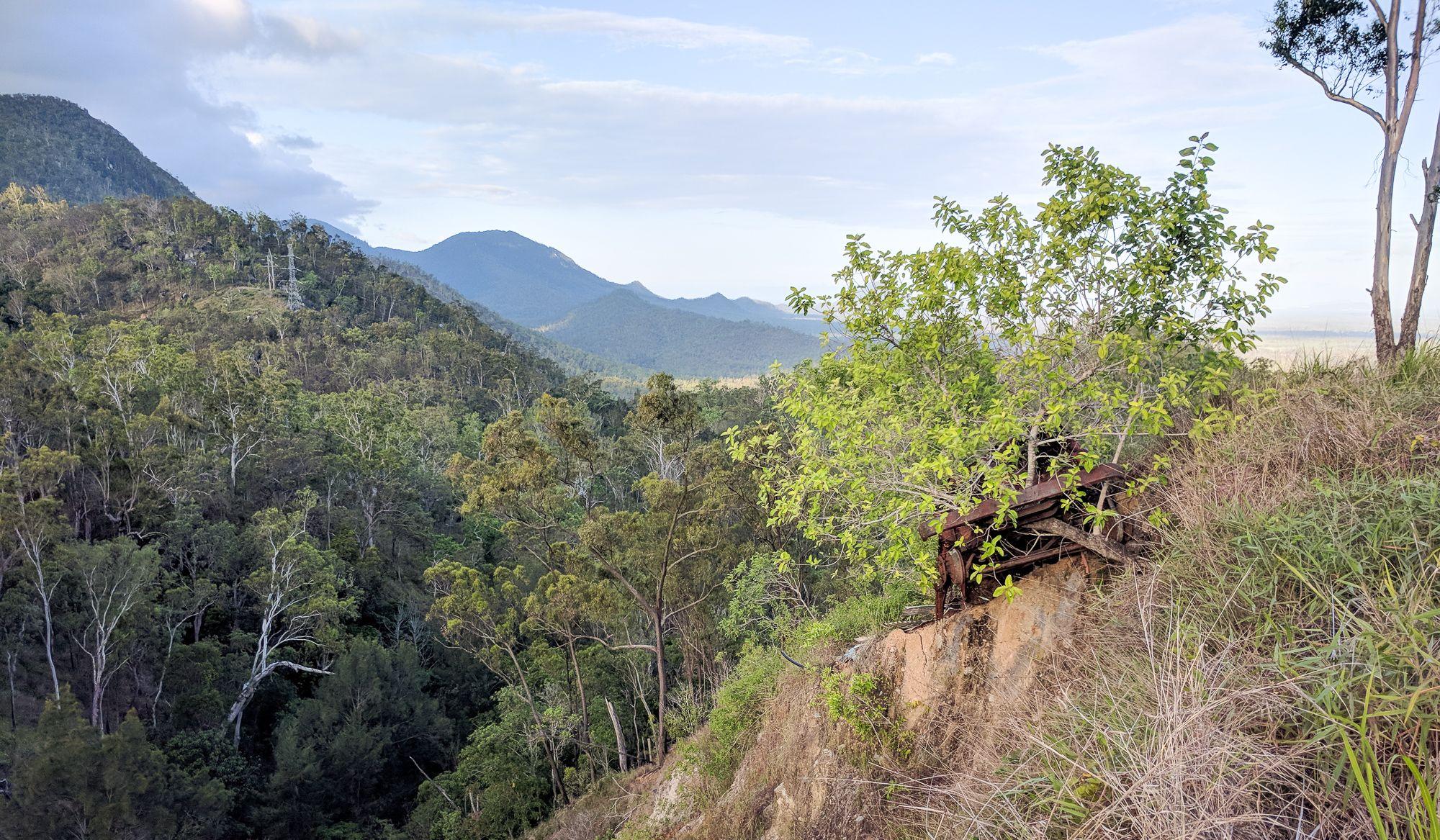 Hervey Range rusty car on hillside